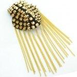 Gold shoulder brooch